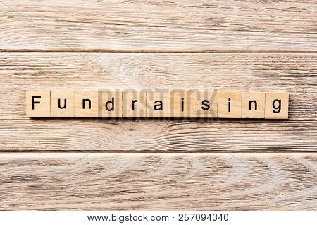 fundraising word written on wood block. fundraising text on table, concept. stock photo