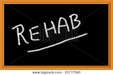 Rehab written on Chalkboard stock photo