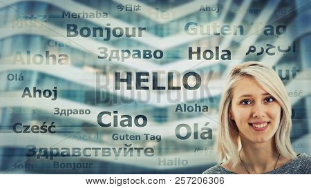 Student girl portrait and word hello translated in different languages on modern background. Young school teacher learning and speaking many languages. International communication concept. stock photo