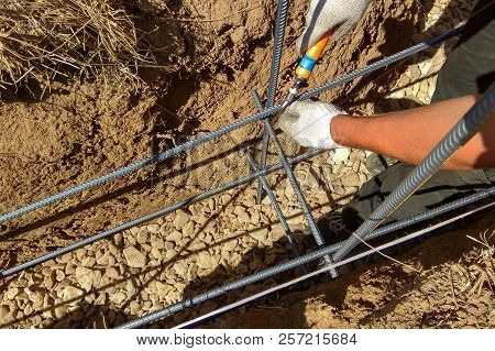 reinforcement of concrete with metal rods connected by wire and wooden formwork stock photo