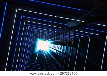 Elevator corridor in the building lit by Blue elumination. Futuristic elevator shaft is located in a high tower. Lift shaft in a residential building. Abstract, background. Bottom view. stock photo