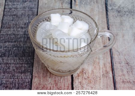A glass of  nipa palm fruit and macapuno coconut ,gelatinous coconut, in syrup stock photo