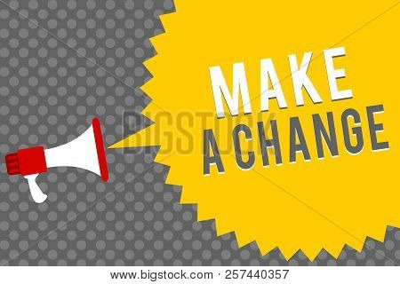 Handwriting text writing Make A Change. Concept meaning Create a Difference Alteration Have an Effect Metamorphose Megaphone loudspeaker speech bubble message gray background halftone. stock photo