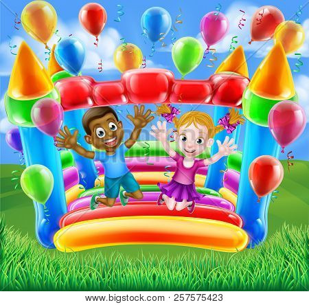 Two kids having fun jumping on a bouncy castle house with balloons and streamers stock photo