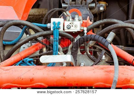Hydraulic system on the tractor, hydraulic hoses, high-pressure oil compressor stock photo