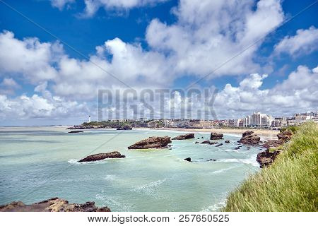 Biarritz city and ocean waves. Bay of Biscay, Atlantic coast, Basque country, France. Summer sunny day and blue sky with white clouds stock photo