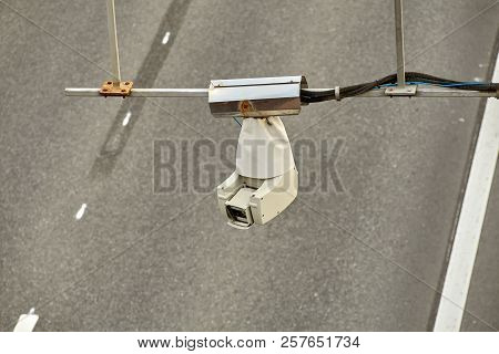 Taffic control surveillance camera CCTV  mounted over highway road. stock photo