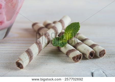 Chocolate biscuits on a light wooden background. Wafers with chocolate. stock photo