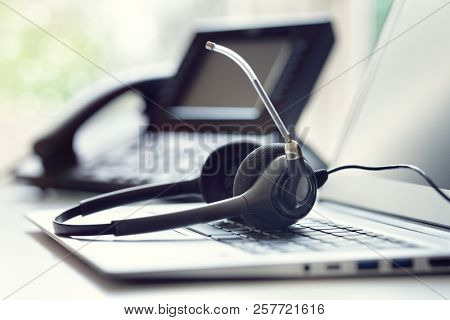 VOIP headset headphones telephone and laptop concept for communication, it support, call center and
