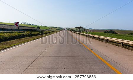 Road highway vehicles on entry ramp view passenger driver perspective through scenic landscape. stock photo
