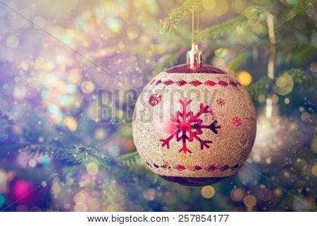 Christmas celebration holiday background - christmas-tree decoration bauble on decorated Christmas t