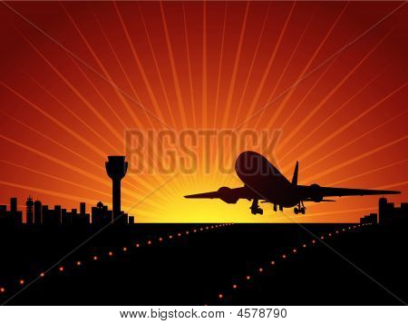 silhouette plane taking off from airport with golden sun setting behind stock photo