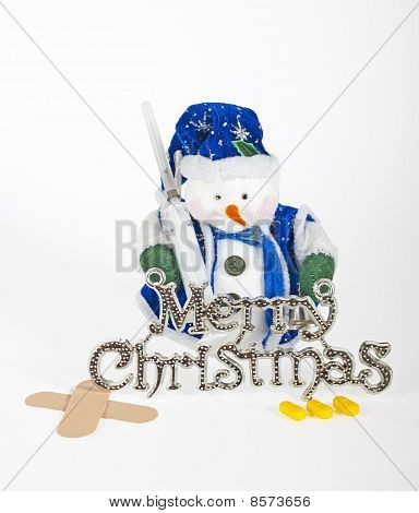 Small snowman decoration with medical equipment isolated on white concept drug abuse at christmas stock photo