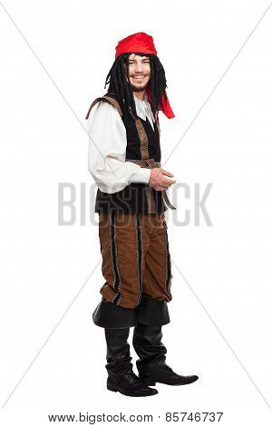 Smiling man dressed as a pirate with dreadlocks isolated on white stock photo