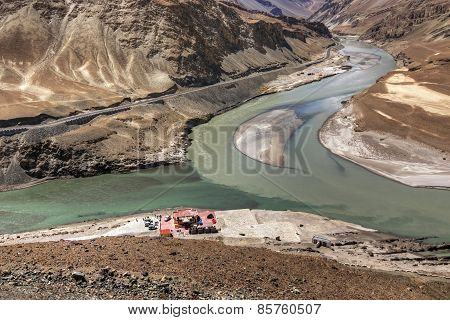 Scenic view of Confluence of Zanskar and Indus rivers - Leh Ladakh Jammu and Kashmir India travel water nature turn change waterbody canyon chadar trek flow curve scenic valley view stock photo