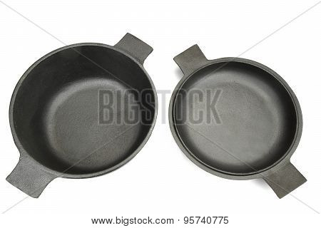 High Angle View On The Opened Clean Empty Cast Iron Pan Isolated On White Background Close-up stock photo