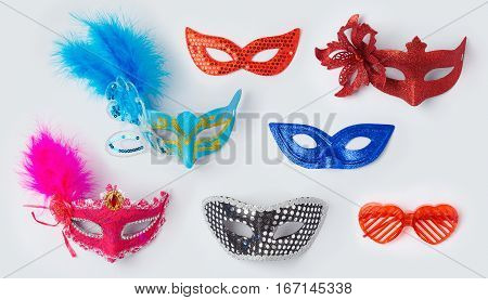 Carnival or mardi gras masks on white background for mock up template design. View from above. Flat lay stock photo