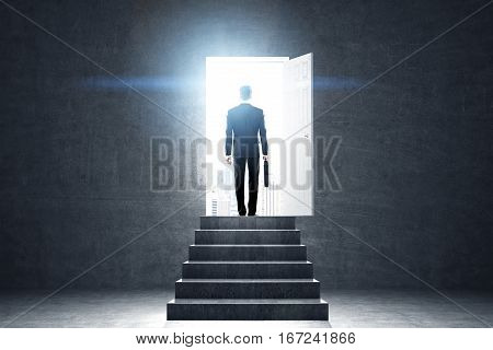 Pathway of opportunity. Back view of businessman exiting concrete room with stairs to enter open door with bright city view. Success concept