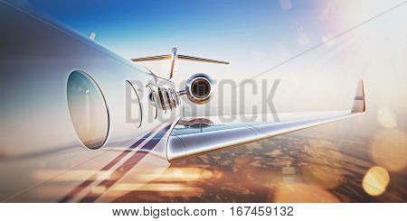 Business travel concept.Generic design of white luxury private jet flying in blue sky at sunset.Uninhabited desert mountains on the background.Horizontal, flares effect. 3D rendering.