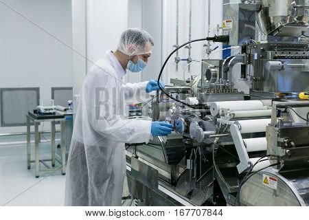 guy in white suit and gas mask check machines work stock photo