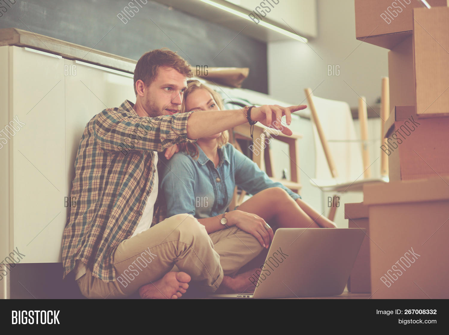 adult,apartment,beginnings,box,break,bright,cardboard,casual,container,couple,daylight,domestic,family,female,floor,hipster,home,homeowner,house,husband,indoors,laptop,lifestyle,looking,love,male,men,moving,movinghouse,new,owner,packing,pause,realpeople,relaxing,rent,rental,sitting,talking,togetherness,two,unpacking,wife