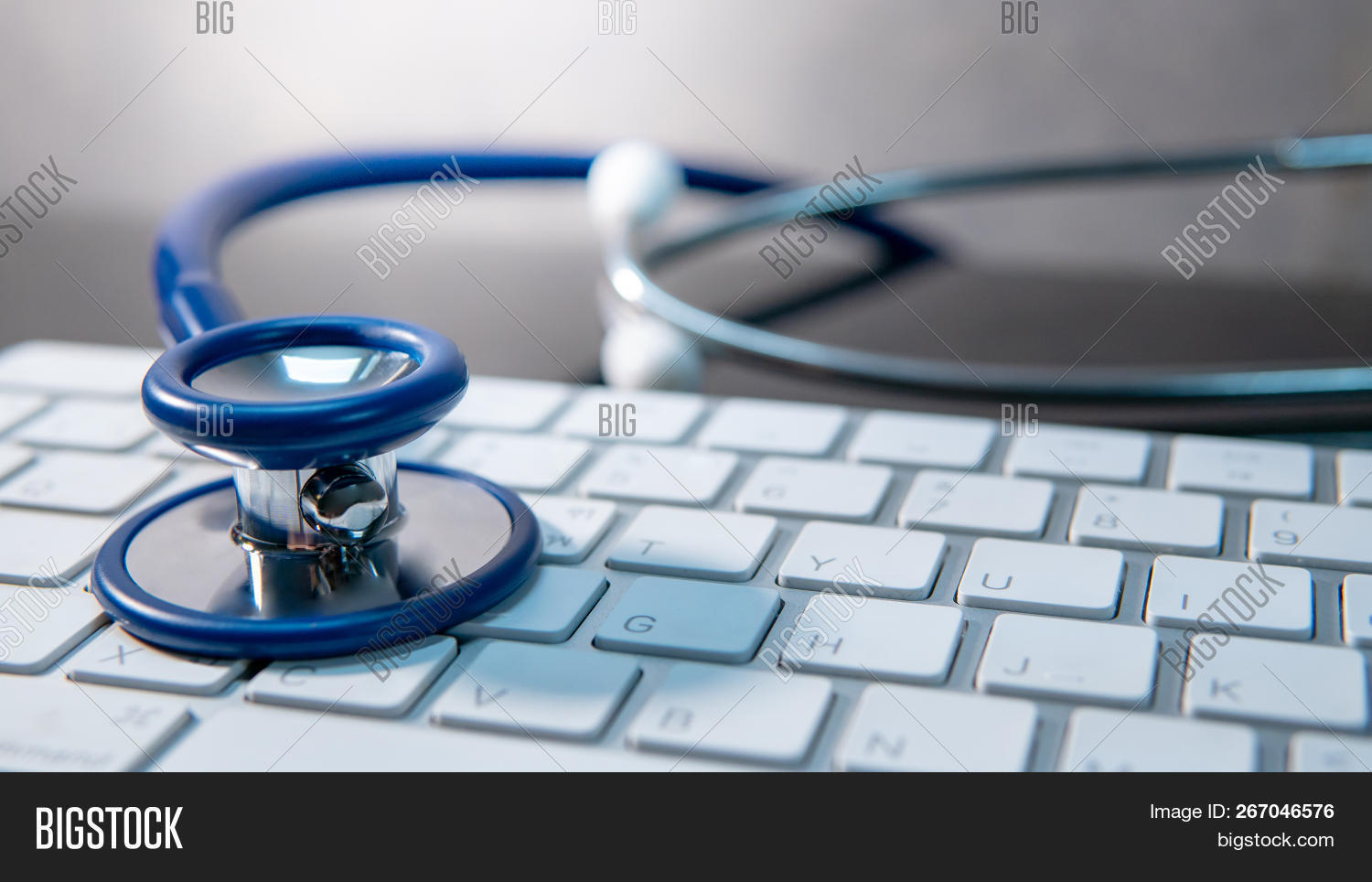 Medical Science Technology Concept. Blue Stethoscope On White Modern Keyboard On Doctor Desk. Health