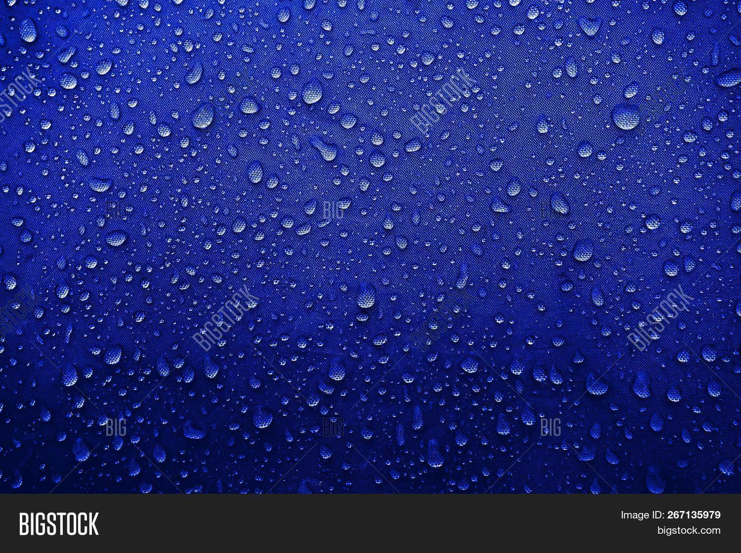 Water Drops On The Fabric. Water Drops On The Background. Condensate. Water Drops Background.