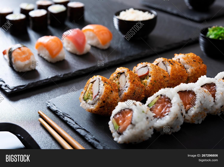 appetizer,asian,avocado,black,blackboard,chopstick,chopsticks,closeup,cuisine,delicacy,delicatessen,delicious,dinner,dish,elegant,fish,food,fresh,freshness,gourmet,healthy,hosomaki,japan,japanese,japanese food,lunch,luxury,maki,meal,menu,nigiri,nigiri sushi,nobody,plate,prawn,raw,restaurant,rice,roll,salmon,seafood,served,slate background,sushi,sushi roll,sushi rolls,tasty,tobiko,traditional,uramaki