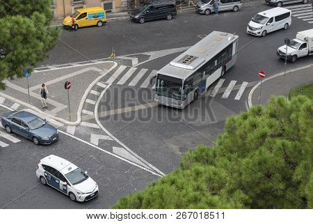 People walk on a pedestrian crossing, view from above. Bus and taxi stand and wait for people to pass. stock photo