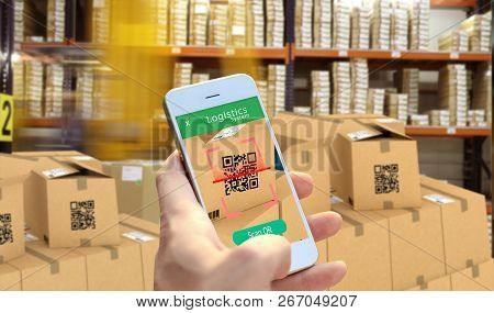 Hand Holding Smart Phone Scanning Package Qr Code At The Warehouse, Smart Logistic, Industry 4.0, Sm