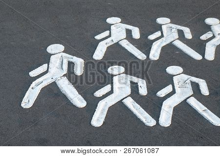 White silhouettes of people. A crowd of people follow the leader. Concept of leadership, crowd psychology for social and business themes stock photo