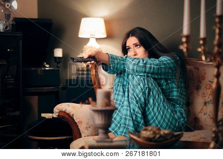 Girl Wearing Pajamas Watching TV in her Room stock photo