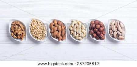 Mix of nuts : Pistachios, almonds , walnuts , pine nut , hazelnuts and cashew . Snack in bowl backgrond stock photo