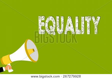 Word writing text Equality. Business concept for state of being equal especially in status rights or opportunities Man holding megaphone loudspeaker green background message speaking loud. stock photo