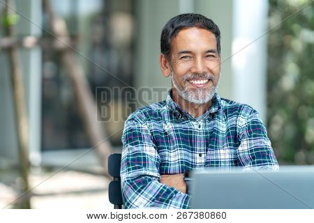 Portrait Of Happy Mature Man With White, Grey Stylish Short Beard Looking At Camera Outdoor. Casual