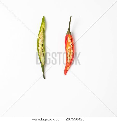 Cut half green and red hot chilli pepper on white background. Copy space for text. Top view or flat lay. Two half peppers isolated on white with clipping path. stock photo