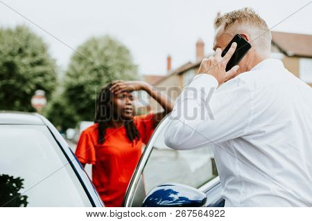 Man calling an insurance after a car accident stock photo