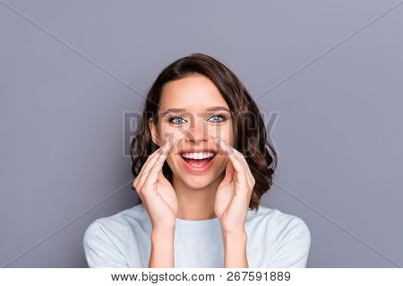 Attractive pretty funny beautiful gorgeous lady with her brunette hairstyle she hold palms near open mouth look at camera stand isolated on gray background stock photo