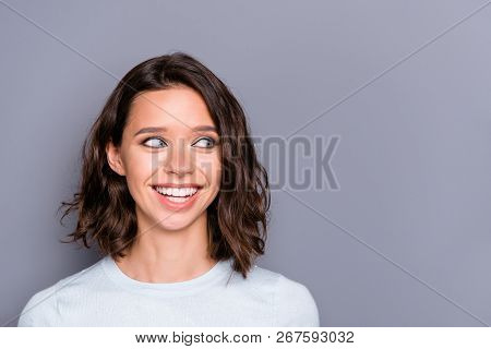 Close up portrait of ecstatic overjoyed lady with her modern haircut she look aside stand isolated on gray background with copy space for text make beaming toothy smile stock photo