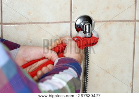 worker is fixing a hose with gripper stock photo