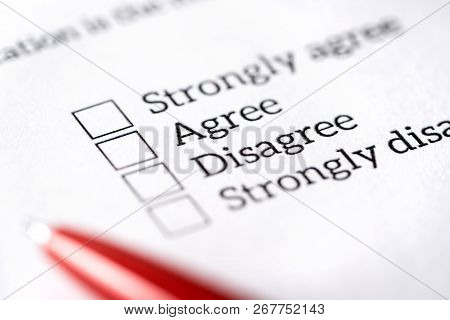 Opinion poll, survey and questionnaire concept. Filling multiple choice question form with paper and pen. Agree or disagree check box. Politics or human resources research, feedback or experience. stock photo