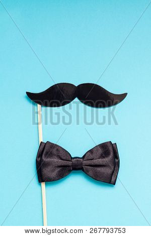 Creative flatlay overhead top view retro stylish black paper photo booth props moustaches turquoise background copy space. Men health awareness month fathers day masculinity concept blog social media stock photo