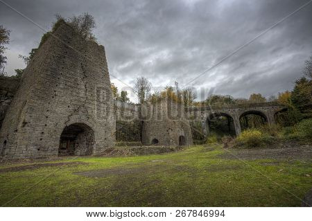 The old blast furnace at the remains of the ironworks at Cwm-y-Felin, Neath Abbey, South Wales, UK stock photo