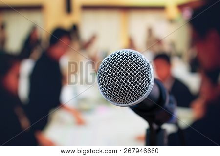 Seminar Conference Concept : Close-up Microphones On Abstract Blurred Of Speech In Meeting Room, Fro