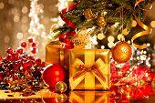 Christmas present box and doodads. Christmas and New Year festivity. Enhanced Christmas tree with va
