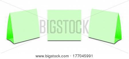 Blank Green Table Tent on white. Paper vertical cards isolated on white background. Front left and right view. stock photo