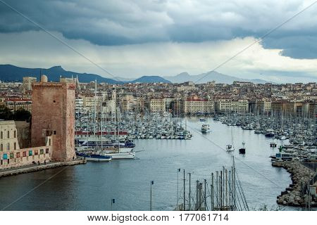 Old Port of Marseille (Also known as Vieux Port) seen from Pharo hill during a spring rainy storm stock photo