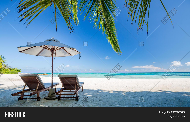background,bahamas,bay,beach,blue,chair,chaise,christmas,coast,coastline,copy,couple,cruise,holiday,horizon,idyllic,island,landscape,leisure,lounge,luxury,maldives,nature,nobody,ocean,paradise,parasol,relax,relaxation,resort,rest,sand,scene,scenic,sea,shore,sky,space,summer,sun,sunny,tourism,travel,tropic,tropical,two,umbrella,vacation,water
