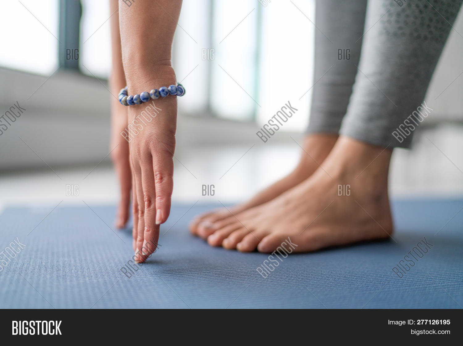 active,activewear,barefoot,blue,bracelet,class,clothes,clothing,exercise,feet,female,fit,fitness,floor,girl,gym,hands,interior,leggings,living,mat,meditating,meditation,morning,people,person,relaxation,relaxing,room,routine,salutation,sport,sportswear,stretches,studio,sun,teacher,tights,toes,training,wellness,woman,women,working,workout,yoga,yogi,zen