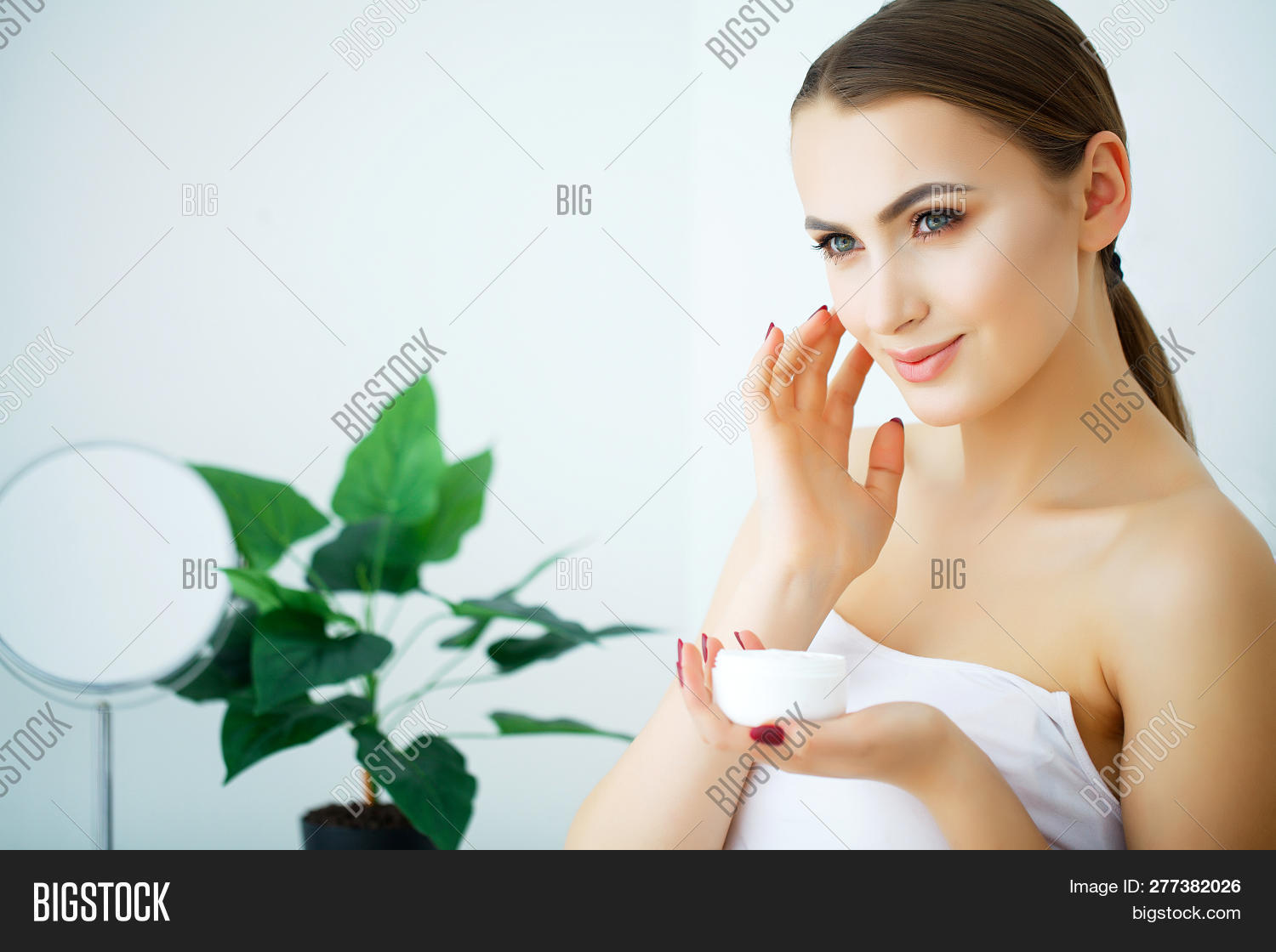 apply,applying,background,beautiful,beauty,body,care,clean,closeup,cosmetic,cream,creme,dermatology,face,facial,female,finger,girl,hand,health,healthy,human,isolated,lotion,moisturiser,moisturizer,moisturizing,people,person,skin,skincare,smooth,spa,treatment,wellness,white,women,young